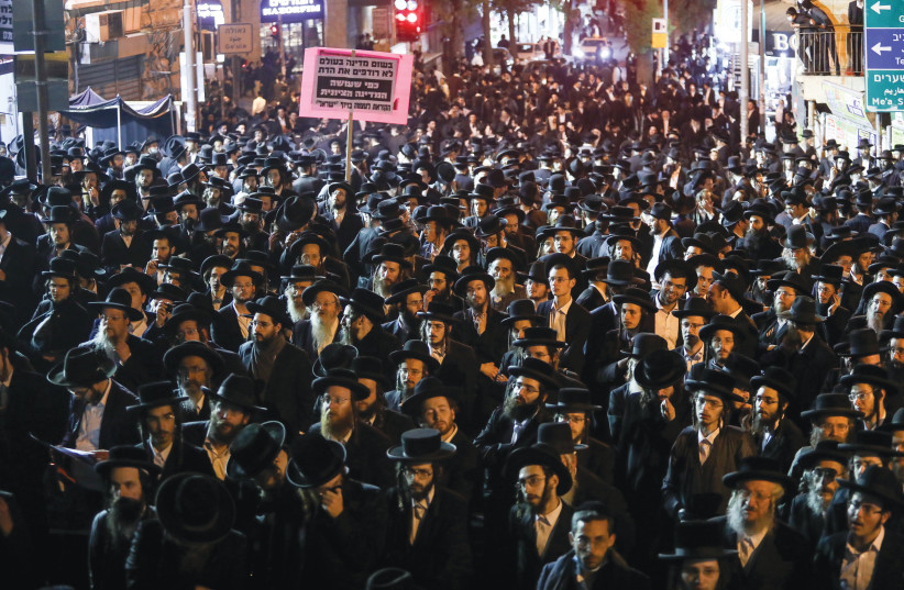 HAREDIM RALLY against coronavirus restrictions in Jerusalem's Mea She'arim neighborhood on February 9. (photo credit: NOAM REVKIN FENTON/FLASH90)