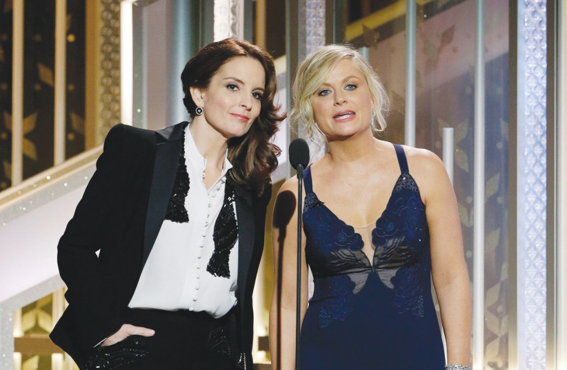 Tina Fey and Amy Poehler hosting Golden Globes in 2015. (photo credit: TNS)