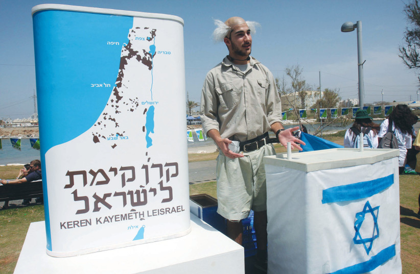 THE FAMOUS KKL-JNF blue box is promoted by a rather tall and lanky David Ben-Gurion impersonator on Independence Day in Tel Aviv in 2009. (photo credit: RONI SCHUTZER/FLASH90)