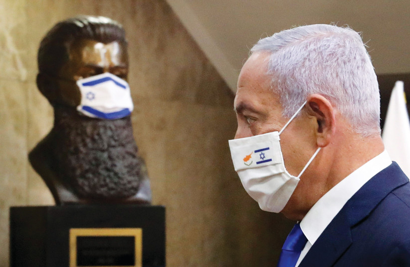 PRIME MINISTER Benjamin Netanyahu at his office on Sunday. Vaccines have been a dominant theme in Likud campaign materials and in Netanyahu's recent interviews. (photo credit: MARC ISRAEL SELLEM/THE JERUSALEM POST)