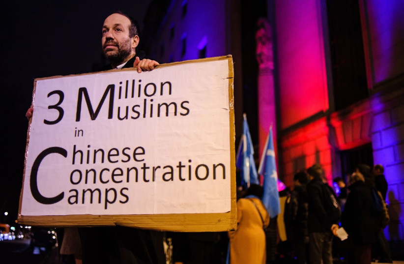 A Jewish man who identified himself as Andrew protests the oppression of China's Uighurs outside the Chinese Embassy in London, Jan. 5, 2020.  (photo credit: GETTY IMAGES)