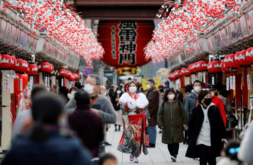 A woman wearing kimono makes her way at Asakusa district, amid the coronavirus disease (COVID-19) outbreak, in Tokyo, Japan (photo credit: REUTERS/KIM KYUNG-HOON)