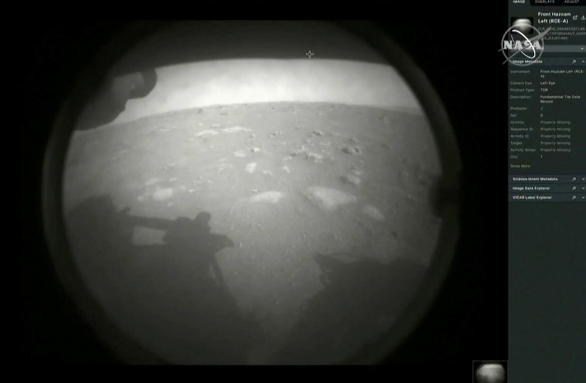 The first images arrive moments after NASA's Perseverance Mars roverspacecraft successfully touched down on Mars (photo credit: REUTERS)