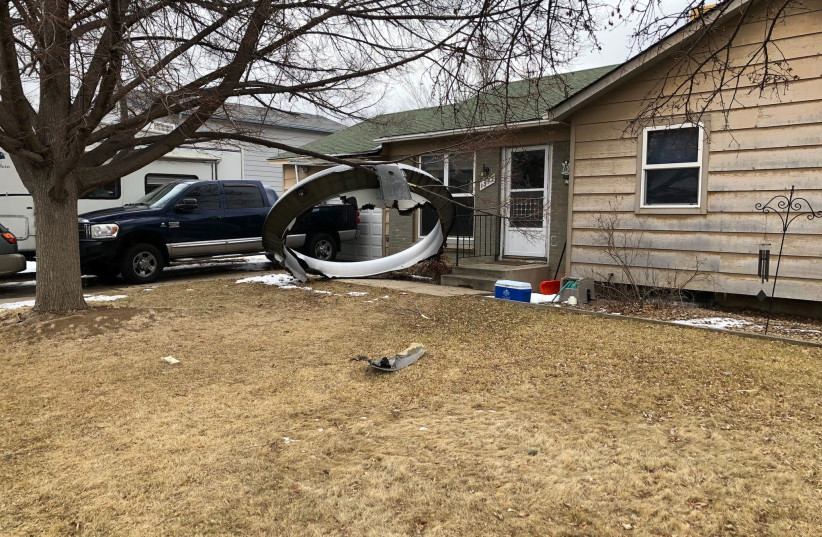 General view of plane debris in Broomfield, Colorado, U.S., February 20, 2021 in this picture obtained from social media. (photo credit: BROOMFILED POLICE VIA REUTERS)