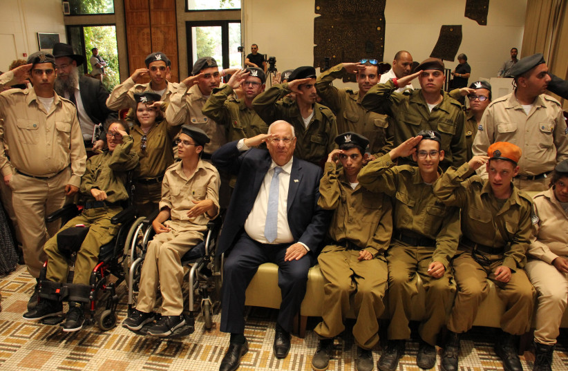 President Reuven Rivlin honors soldiers from Special in Uniform as he celebrates their contributions to the Israel Defense Forces. (photo credit: JNF USA)