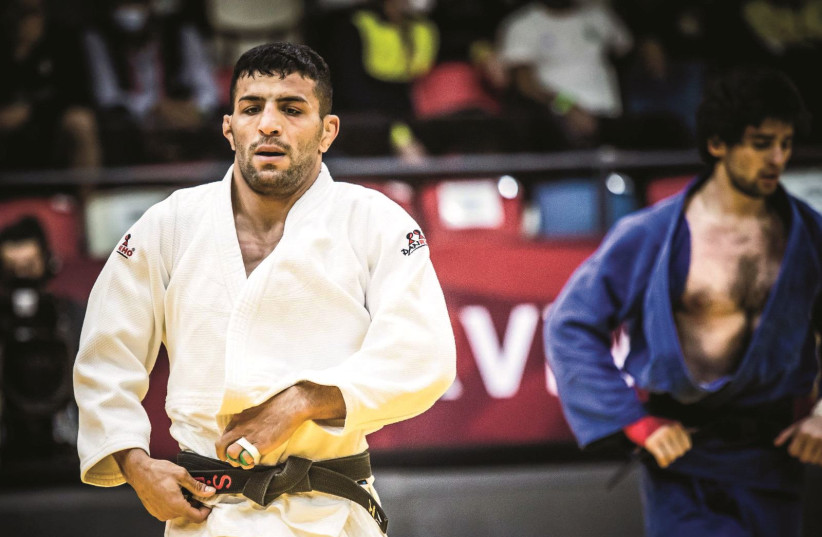 IRANIAN SAIEID MOLLAEI, who fled his country after ignoring orders to drop out of a match in 2019 to avoid facing Israeli judoka Sagi Muki, won a silver medal over the weekend at the Tel Aviv Grand Slam at the Drive-In Arena. (photo credit: ODED KARNI/ISRAEL JUDO ASSOCIATION)