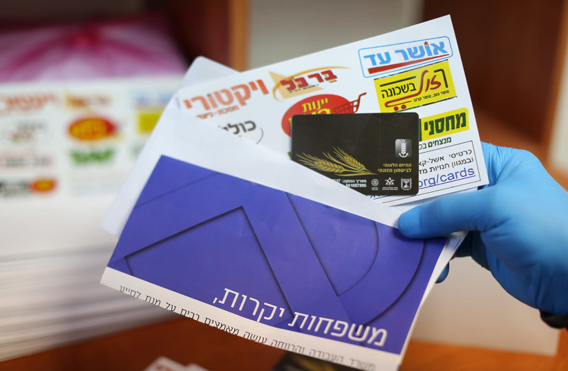 The envelope containing the 'food debit cards' that families in need will receive to address the economic crisis they have been dealing with due to the coronavirus pandemic, February 22, 2021.  (photo credit: Courtesy)