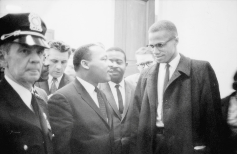 Martin Luther King Jr. and Malcolm X wait for a press conference to begin in an unknown location, March 26, 1964 (photo credit: CONGRESS/MARION S. TRIKOSKO/HANDOUT VIA REUTERS)