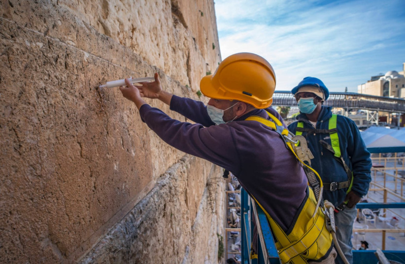 The Western Wall stones are injected with a special mixture to preserve and reinforce them (photo credit: YANIV BERMAN/IAA)