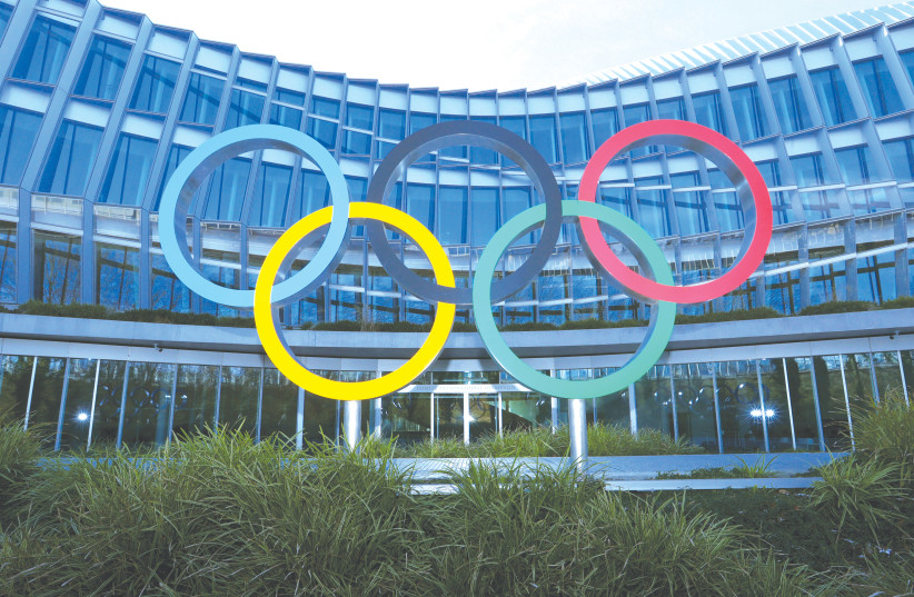 THE OLYMPIC rings are pictured in front of the International Olympic Committee (IOC) headquarters during the coronavirus disease (COVID-19) outbreak in Lausanne, Switzerland last month. (photo credit: DENIS BALIBOUSE/REUTERS)