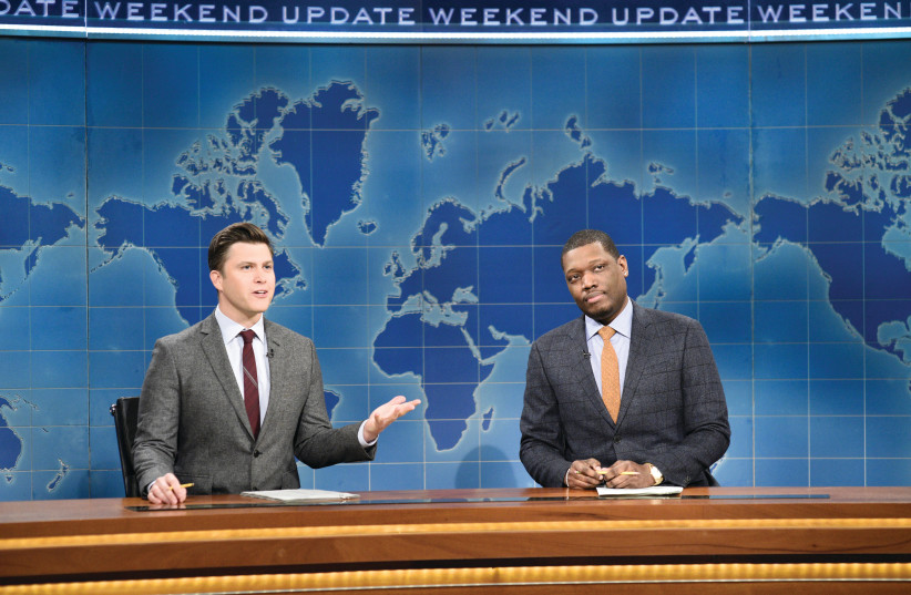 ANCHOR COLIN JOST (left) and anchor Michael Che during Weekend Update on 'Saturday Night Live' last year. (photo credit: WILL HEATH/NBC/TNS)