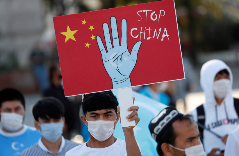 Ethnic Uighur demonstrators take part in a protest against China, in Istanbul, Turkey October 1, 2020. (photo credit: REUTERS/MURAD SEZER)