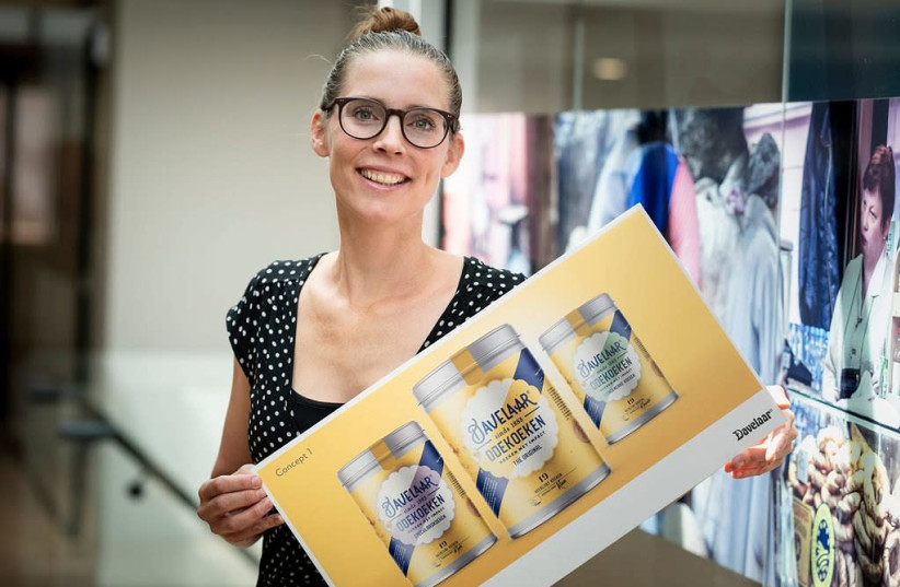 Renee Paterpresents the design for the new label that her company, Patisserie Pater, produces in Zwaagdijk, the Netherlands.  (photo credit: PATISSERIE PATER)