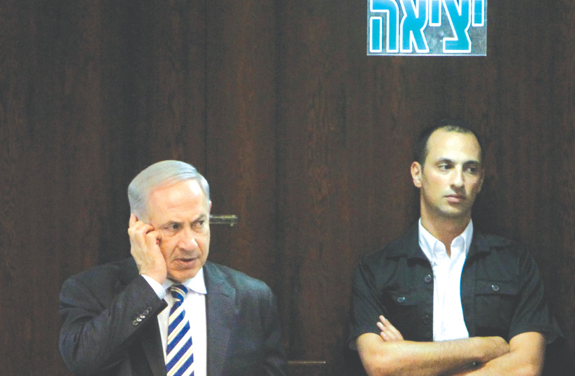 PRIME MINISTER Benjamin Netanyahu on a cellphone - 'the president is calling.' (photo credit: MIRIAM ALSTER/FLASH90)
