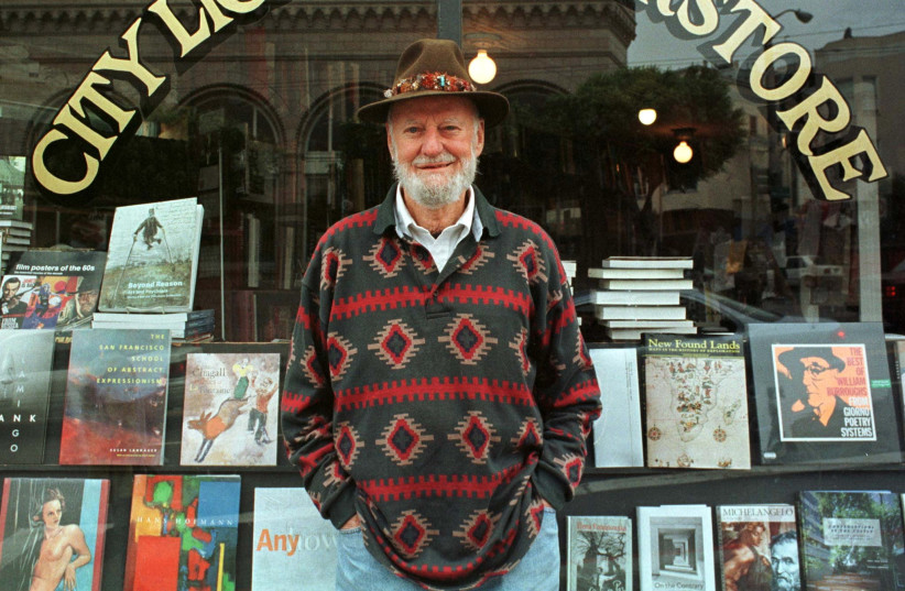 Lawrence Ferlinghetti stands outside his bookstore in San Francisco (photo credit: REUTERS)