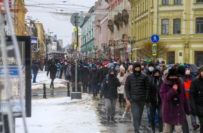 Opposition political leader Alexey Navalny's supporters seen marching in (photo credit: Courtesy)