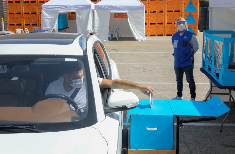 Drive-by voting in the Israeli election amid the coronavirus pandemic 2021 (photo credit: MARC ISRAEL SELLEM)