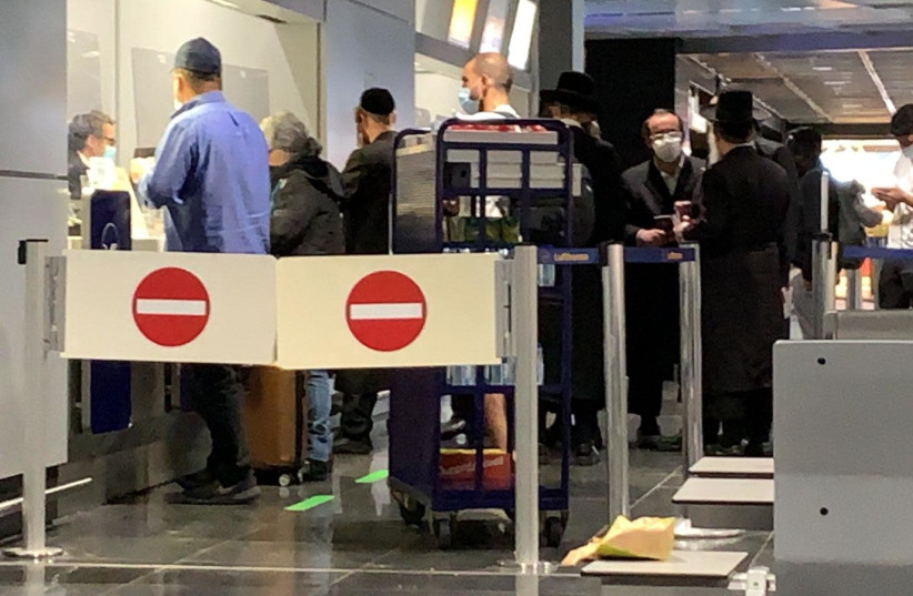 Israeli passengers wait to board the Lufthansa flight intended to bring them back to Israel, February 24, 2021.  (photo credit: ALANA RUBEN)