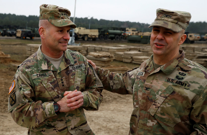 US Army Europe Commander Christopher Cavoli and US Army Europe Director of Public Affairs Joe Scrocca attend a media briefing after deployment of US troops from 2nd Armored Brigade Combat Team, 1st Armored Division for military exercises in Drawsko Pomorskie training area, Poland March 21, 2019.  (photo credit: REUTERS/KACPER PEMPEL)