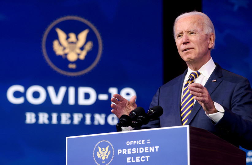 US President-elect Joe Biden delivers remarks on the US response to the coronavirus disease (COVID-19) outbreak, at his transition headquarters in Wilmington, Delaware, US, December 29, 2020. (photo credit: REUTERS/JONATHAN ERNST/FILE PHOTO)
