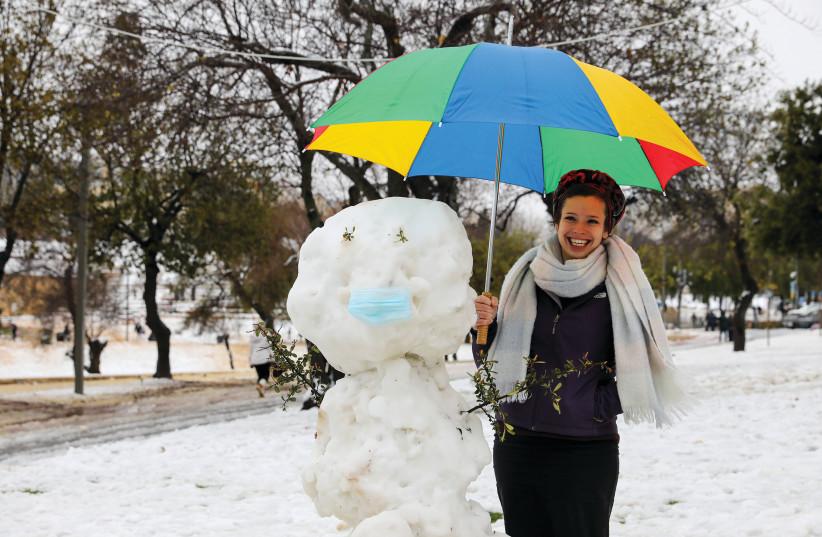 A rare snowfall in Jerusalem's Sacher Park on February 18, 2021 (photo credit: MARC ISRAEL SELLEM)