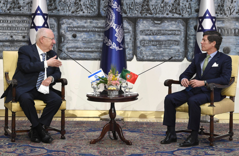 President Reuven Rivlin is seen meeting with Portugal's Ambassador to Israel Jorge Tito de Vasconcelos Nogueira Dias Cabral at the President's Residence, on February 24, 2021. (photo credit: MARK NEYMAN/GPO)