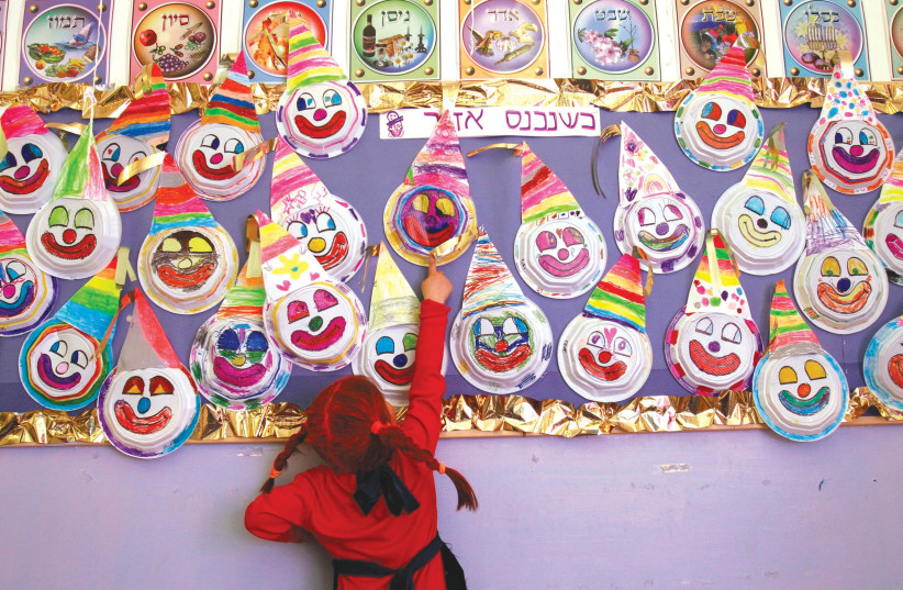 Making merry at a school Purim party in years past (photo credit: NATI SHOHAT/FLASH90)