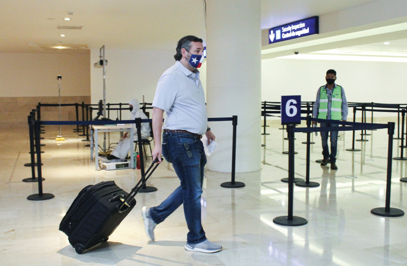 SEN. TED CRUZ wheels his luggage through Mexico's Cancun International Airport before boarding his plane back to the US last Thursday. (photo credit: REUTERS)