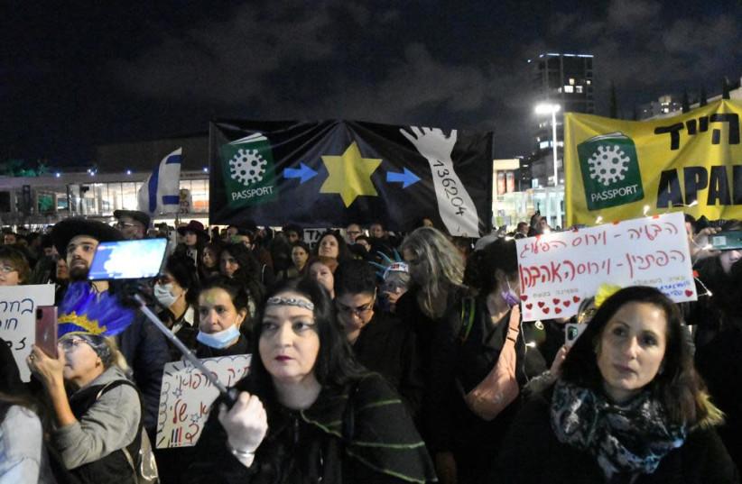Israelis protest the government's COVID-19 vaccination campaign near HaBima Theater in Tel Aviv, Feb. 24, 2021. (photo credit: AVSHALOM SASSONI/MAARIV)