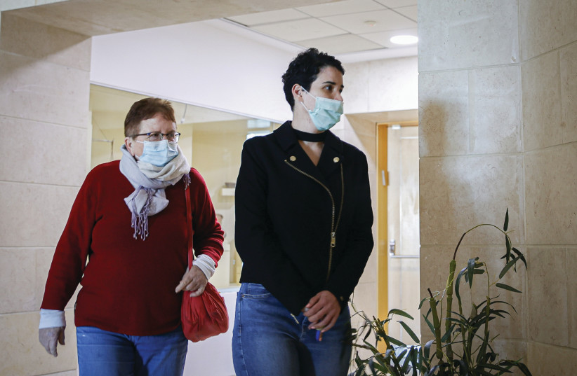 SHIRA ISAKOV (right) arrives earlier this week for a Beersheba court hearing of Aviad Moshe, who tried to murder her in Mitzpe Ramon a few months ago. (photo credit: FLASH90)