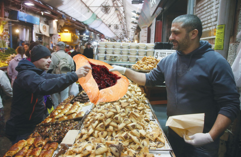 A SHOPPER in Jerusalem's Mahaneh Yehuda buys his family's food for the week yesterday. (photo credit: COMPOSITE PHOTO BY OLGA LEVI/REUTERS/FLASH90/WIKIMEDIA COMMONS)