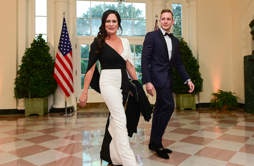 White House Press Secretary Stephanie Grisham arrives with Max Miller for a State Dinner for Australia's Prime Minister Scott Morrison at the White House (photo credit: ERIN SCOTT/REUTERS)