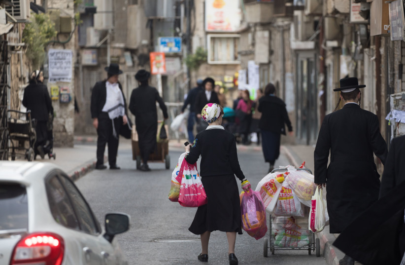 A typical street scene in the bustling modern-day shtetl of Jerusalem's Mea She'arim neighborhood. (photo credit: YONATAN SINDEL/FLASH90)