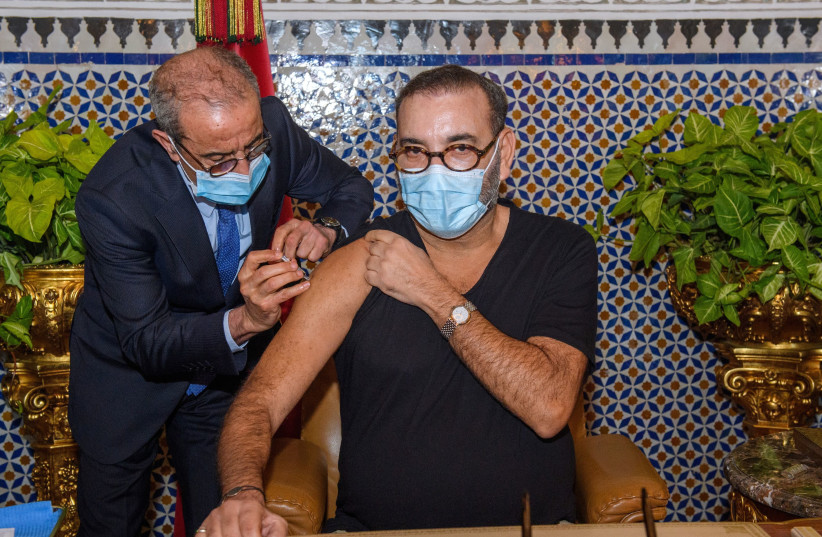 Morocco's King Mohammed VI receives a dose of a COVID-19 vaccine at the Royal Palace in Fez, Morocco as he inaugurates Morocco's national coronavirus vaccination campaign, Jan 28, 2021 (photo credit: MOROCCAN ROYAL PALACE PRESS SERVICE/HANDOUT VIA REUTERS)