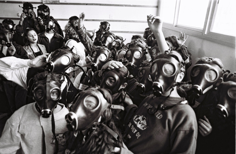 Crowding into a sealed room during the Gulf War, 1991. (photo credit: MOSHE SHAI/FLASH90)