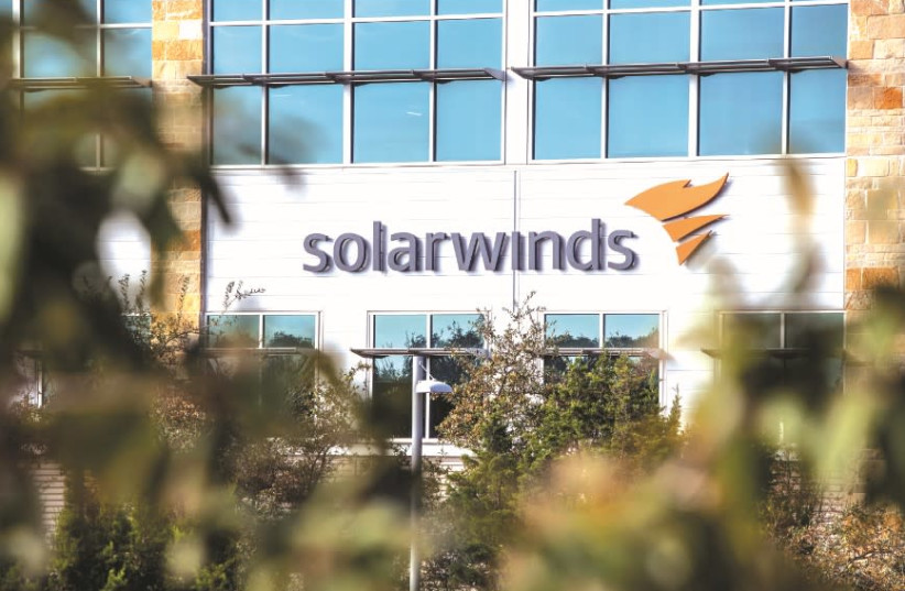 THE SOLARWINDS logo is seen outside its headquarters in Austin, Texas, in December. (photo credit: REUTERS/SERGIO FLORES)