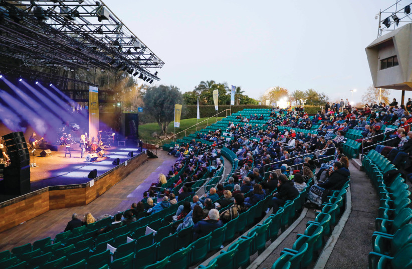 NURIT GALRON performs Wednesday night at the Wohl Amphitheater in Tel Aviv for the city's vaccinated senior residents. (photo credit: GUY YECHIELY)