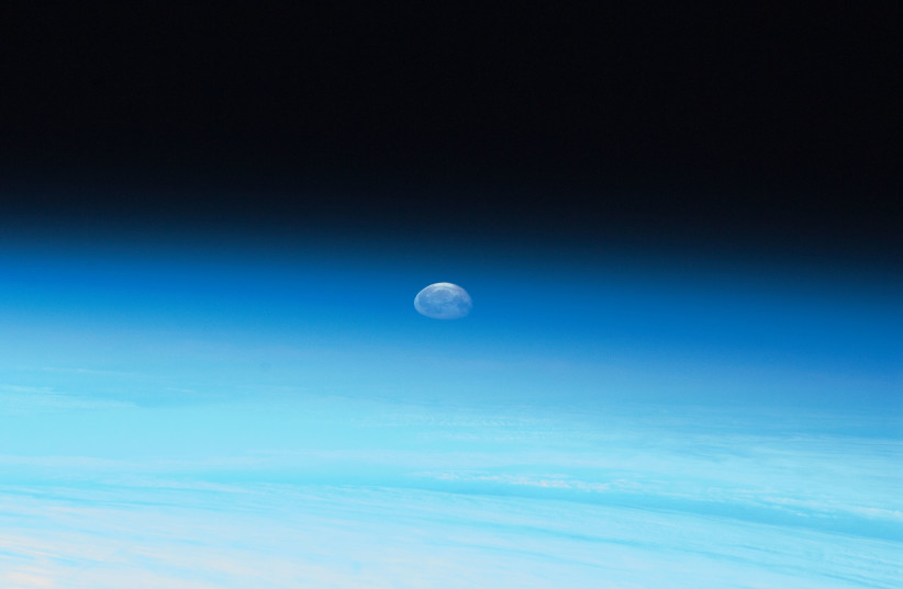 Moon and Earth's Atmosphere (photo credit: NASA)