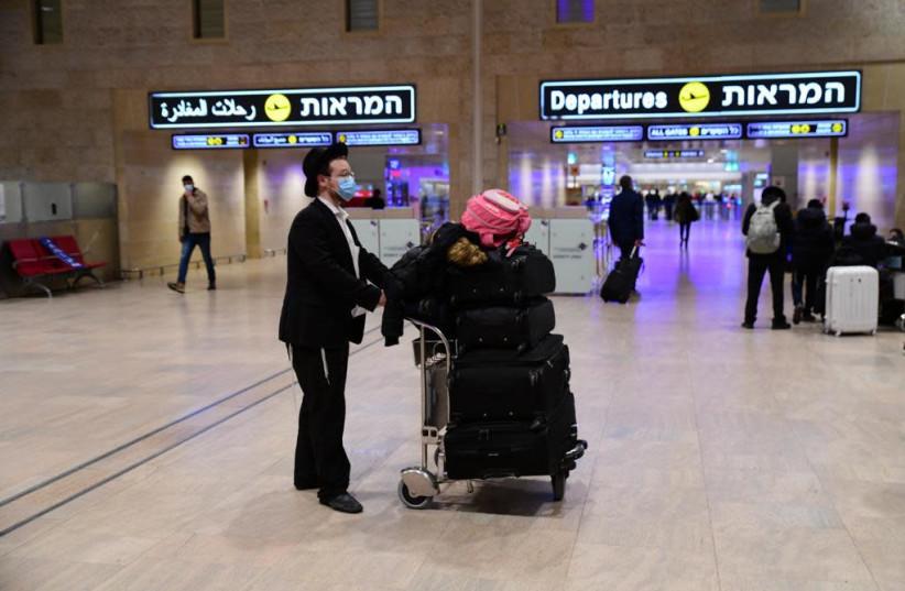 Passengers in Ben-Gurion Airport amid ongoing coronavirus restrictions, Feb. 2021 (photo credit: AVSHALOM SASSONI/ MAARIV)