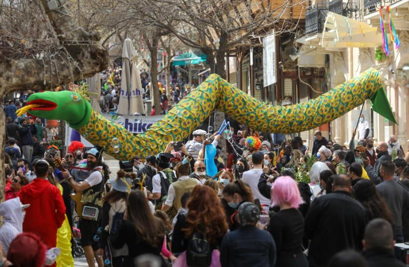 Shushan Purim celebrations amid ongoing coronavirus outbreak in Jerusalem, Feb. 28, 2021 (photo credit: MARC ISRAEL SELLEM)