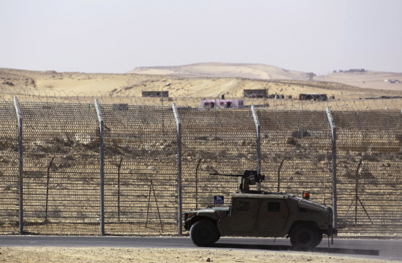 Armoured Israeli military vehicle driving along border with Egypt (photo credit: AMIR COHEN/REUTERS)