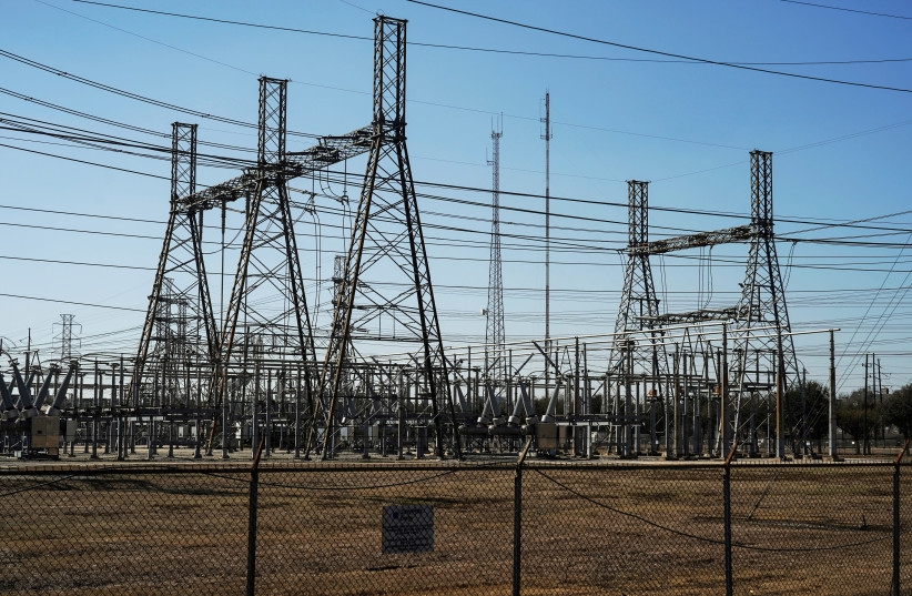 An electrical substation is seen after winter weather caused electricity blackouts in Houston, Texas, US, February 20, 2021 (photo credit: GO NAKAMURA/REUTERS)