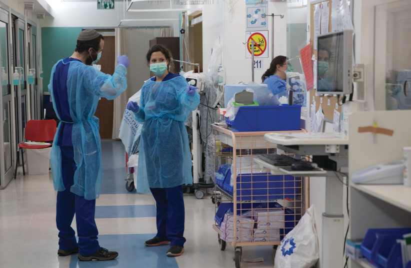 A MEDICAL TEAM is seen working at the new biological emergency unit dedicated to COVID-19 at Shaare Zedek Medical Center, in Jerusalem, last year. (photo credit: NATI SHOHAT/FLASH90)