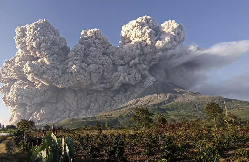 Mount Sinabung volcano erupts as seen from Kuta Rakyat village in Karo (photo credit: REUTERS)
