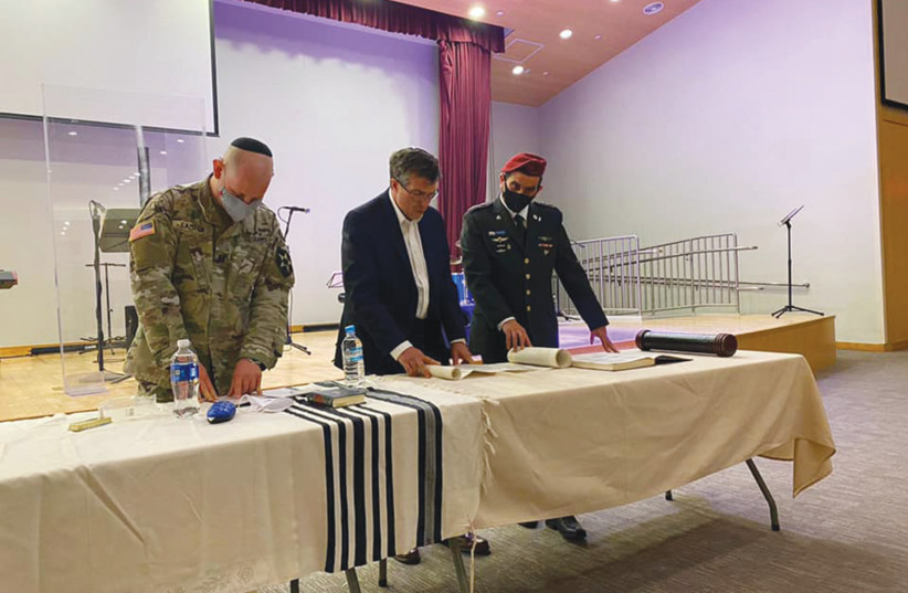 AMBASSADOR AKIVA TOR, with two US Army officers, reading the megillah. (photo credit: Courtesy)