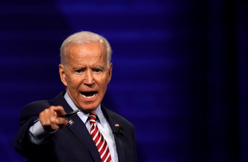 Democratic 2020 US presidential candidate and former Vice President Joe Biden reacts during a televised townhall on CNN dedicated to LGBTQ issues in Los Angeles, California, US October 10, 2019.  (photo credit: REUTERS/MIKE BLAKE)