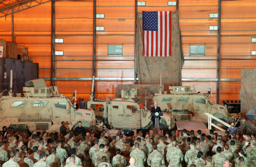 Then-US vice president Mike Pence delivers remarks to U.S. troops at Al Asad Air Base, Iraq November 23, 2019 (photo credit: REUTERS/JONATHAN ERNST)