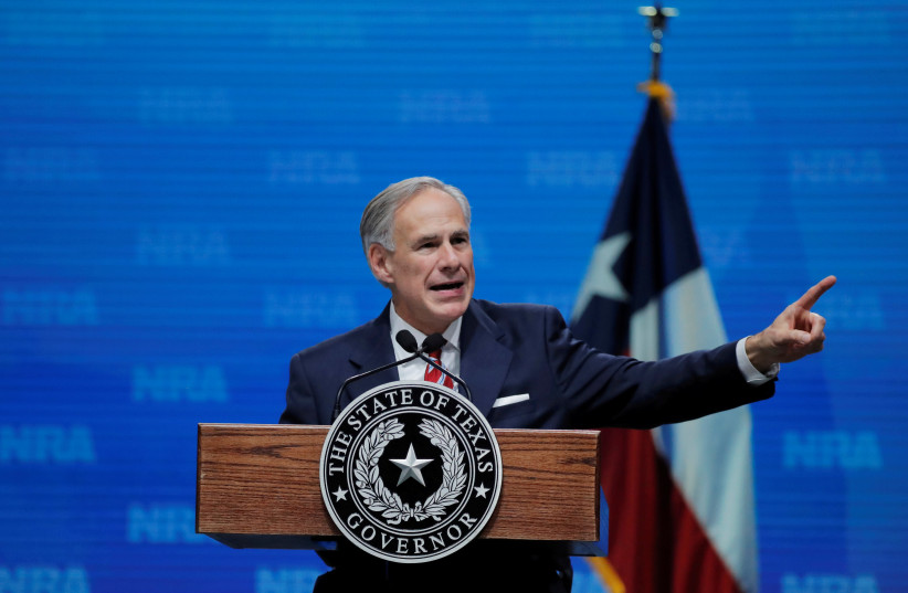 Texas Governor Greg Abbott speaks at the annual National Rifle Association (NRA) convention in Dallas, Texas, May 4, 2018 (photo credit: REUTERS/LUCAS JACKSON/FILE PHOTO)
