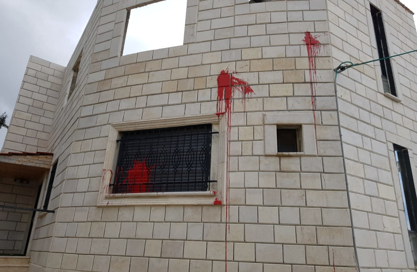 Red paint bomb thrown at a house at the Palestinian village of Hawara in the West Bank, Wednesday, March 3, 2021.  (photo credit: HAWARA MUNICIPALITY AND YESH DIN)
