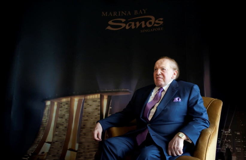 Las Vegas Sands Chairman Sheldon Adelson sits down before an interview with Reuters in Singapore July 8, 2009. (photo credit: REUTERS)